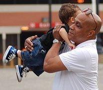 Grandfather lifting grandson