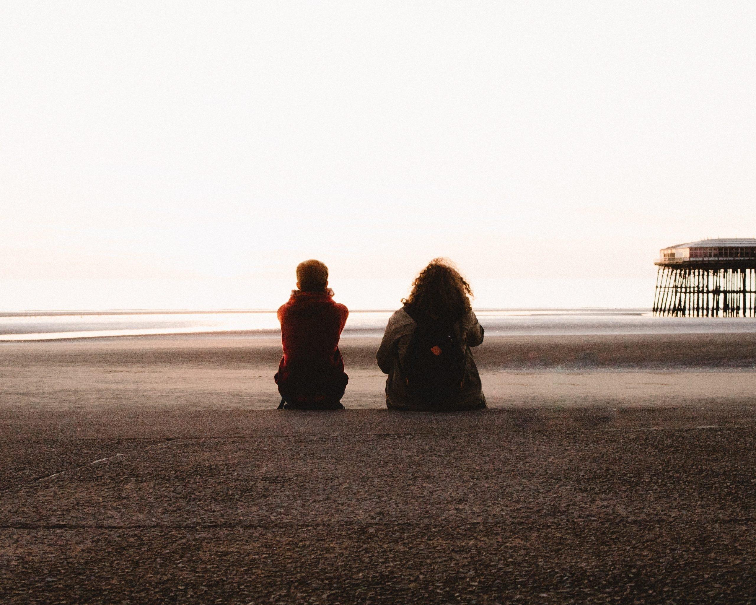Friends on the beach talking